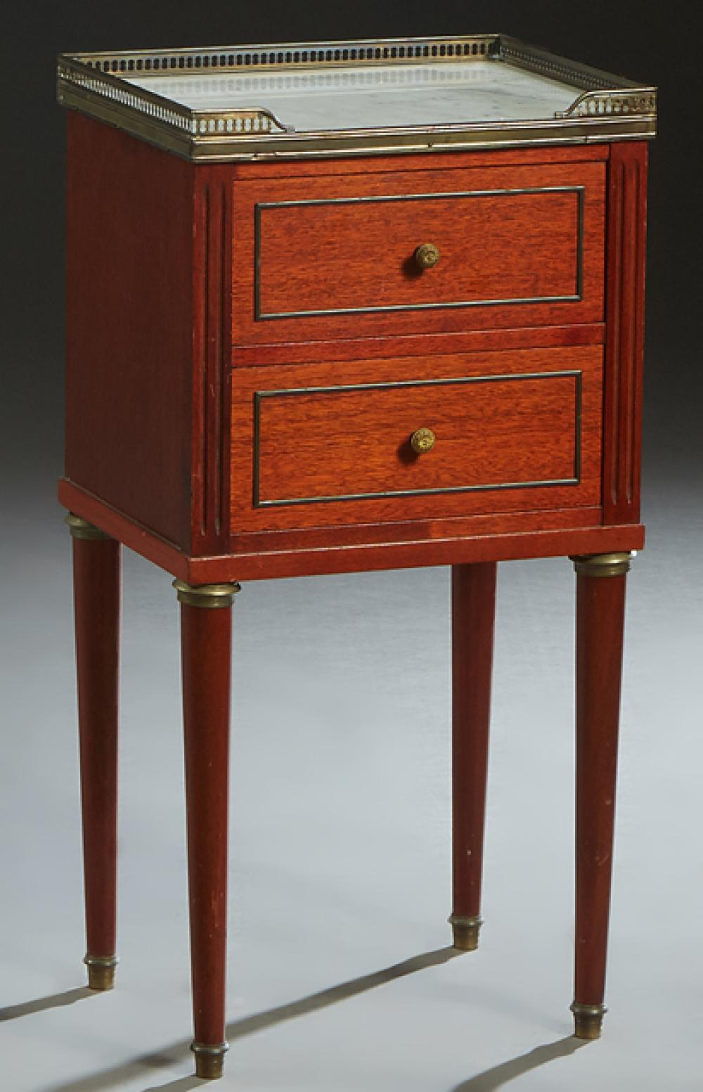 French Louis XVI Style Carved Mahogany Marble Top Nightstand, 20th c., the brass galleried top with an inset figured white marble ab...