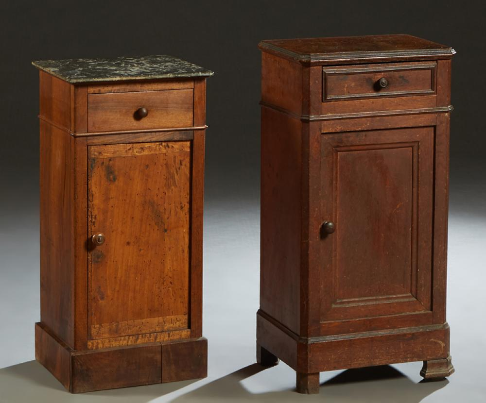 Two French Louis Philippe Carved Walnut Nightstands, 19th c., one with a highly figured gray marble top over a frieze drawer and a l...