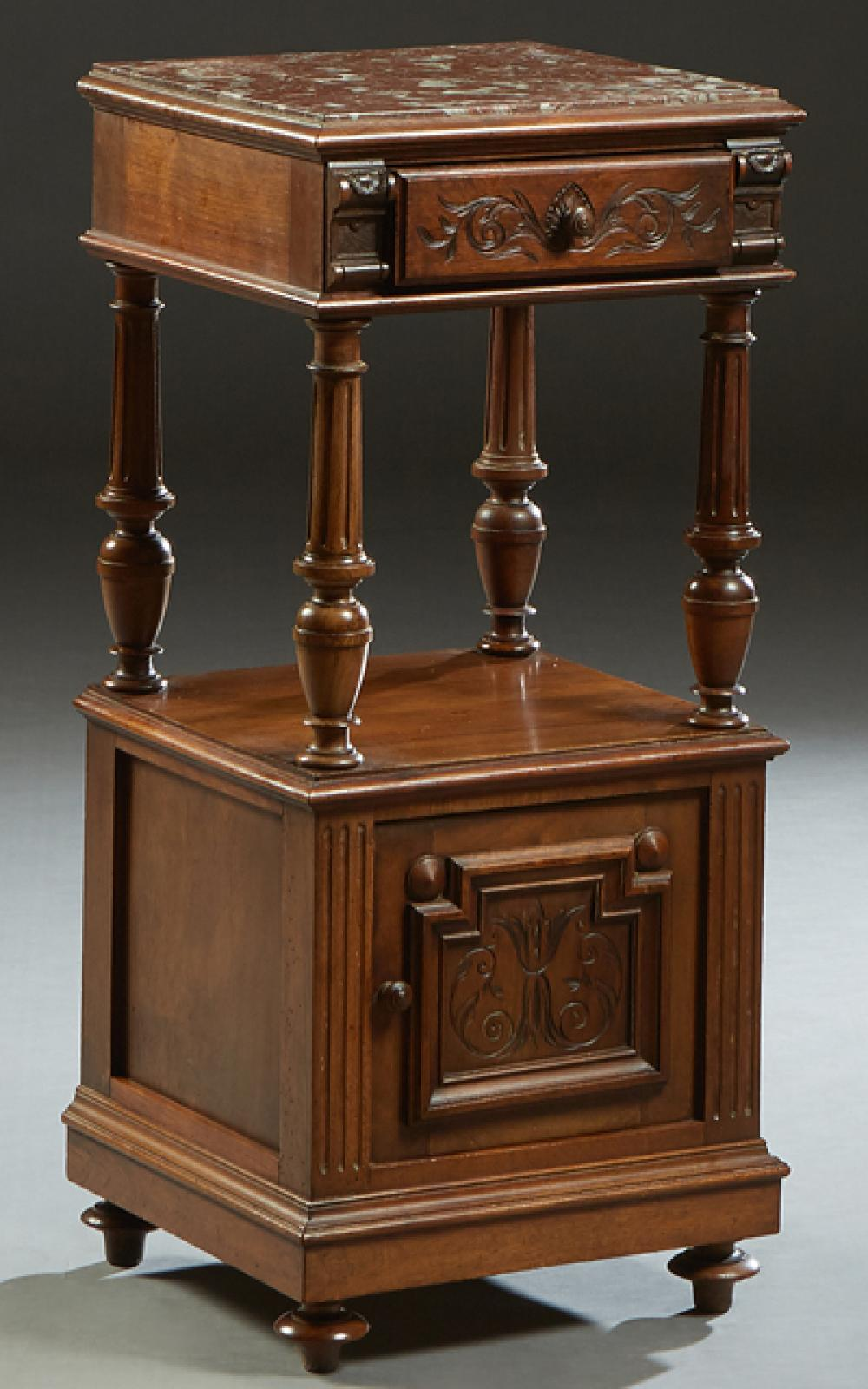 French Henri II Style Carved Walnut Marble Top Nightstand, early 20th c., the inset highly figured brown marble over a frieze drawer...