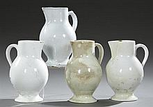 Group of Four French Provincial Glazed Earthenware Pitchers, 19th c., Luneville, three marked oil, one vinegar, tallest- H.- 9 3/4 i...