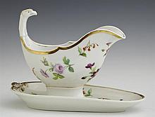 Sevres Style Gravy Boat and Flat, 19th c., with gilt and floral decoration, the boat with a relief eagle handle, H.- 7 in., W.- 7 3/...