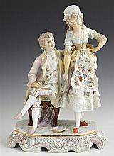 Rudolstadt Porcelain Figural Group, c. 1900, #1912, depicting a couple in 19th c., costume, on an octagonal base with gilt and polyc...