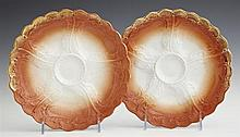 Pair of German Oyster Plates, c. 1920, marked Weimar, with gilt rims and relief decoration, H.- 1 1/4 in., Dia.- 8 1/4 in.