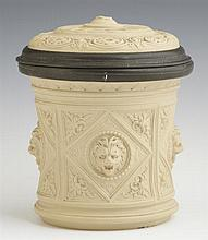 Unusual Ceramic and Pewter Tobacco Jar, 19th c., the sides with relief lions heads, probably Mettlach, H.- 5 1/2 in., Dia.- 5 3/8 in.