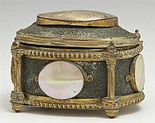 Oval Bronze Trinket Box, 19th c., the lid and sides with oval mother of pearl mounts, on turned feet, H.- 2 1/2 in., W.- 3 3/4 in.,...