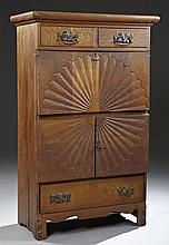 American Carved Oak Drop Front Secretary, c. 1890, with two frieze drawers, over a drop front desk with an interior fitted with a dr...