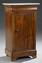 Louis Philippe Carved Walnut Marble Top Nightstand, c. 1850, the rounded corner white marble over a frieze drawer and a long cupboar...