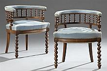 Pair of Carved Beech Jacobean Style Roundabout Upholstered Armchairs, c. 1900, the upholstered backs on rope twist spindled supports...