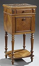 Louis XVI Style Carved Walnut Marble Top Nightstand, c. 1900, the inset highly figured brown marble over a frieze drawer and a fall...