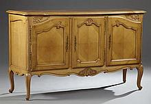 Louis XV Style Carved Cherry Sideboard, 20th c., the serpentine parquetry inlaid top over three arched panel cupboard doors with lon...