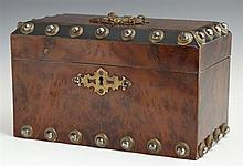 Metal Mounted Burled Satin Mahogany Tea Caddy, c. 1870, the lid with a patinated metal relief plaque of two putti, the canted corner...
