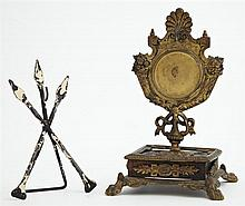 Two Pocket Watch Holders, 19th c., one wrought iron of spear form, the other gilt bronze with relief decoration, on a bronze mounted...