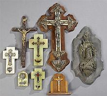 Group of Eight Religious Items, c. 1900, consisting of a crucifix with holy water font, a gesso crucifix, a wood table top crucifix,...