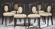Set of Six French Louis XVI Style Carved Mahogany Side Chairs, c. 1870, the bead carved crest rail, over an upholstered medallion sp...