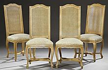 Set of Four Louis XV Style High Back Carved Beech Dining Chairs, 20th c., the arched back with caned panels, over bowed upholstered...