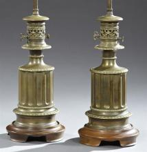 Pair of Victorian Brass Oil Lamps, late 19th c., of reeded columnar form, now electrified and mounted on custom mahogany bases as la...