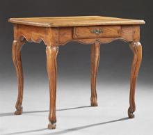 Louis XV Style Carved Walnut Side Table, 19th c., the stepped ogee edge rounded corner top over serpentine skirt with a frieze drawe...