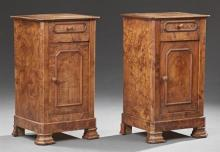 Pair of Louis Philippe Style Carved Elm Nightstands, 19th c., the canted corner square top over a frieze drawer above a cupboard doo...