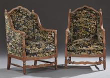 Pair of Upholstered Walnut Diminutive Wing Armchairs, c. 1880, the serpentine arched crest rail flanked by finials above a bowed cus...