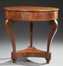 French Empire Style Carved Walnut Circular Table, 19th c., the circular top over a wide skirt with two frieze compartment drawers an...