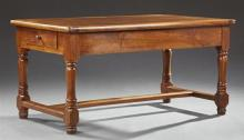 French Provincial Louis XIII Style Carved Cherry Farmhouse Table, late 19th c., the five board top over a wide skirt with two end dr...