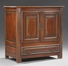 French Provincial Louis XIV Style Carved Oak Sideboard, 19th c., the rounded corner rectangular top over double fielded panel cupboa...