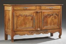 French Louis XV Style Carved Walnut Sideboard, 19th c., the rectangular canted corner top over double frieze drawers, above two cupb...