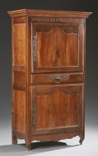 French Louis XV Style Carved Cherry Homme Debout, 19th c., the stepped ogee crown over a cupboard door with iron escutcheons and lon...