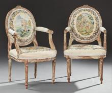 Pair of French Louis XVI Style Carved Giltwood Fauteuils, 19th c., the floral carved medallion backs over upholstered arms and bowed...