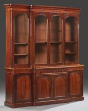 English Victorian Style Mahogany Bookcase Cupboard, early 20th c., the rounded corner stepped edge breakfront crown crotched above d...