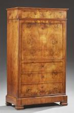 French Louis Philippe Carved Walnut Secretaire Abattant, 19th c., the stepped edge top over a frieze drawer and a fall front with an...