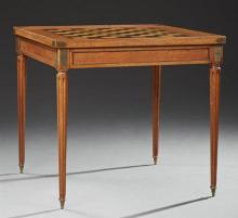 French Louis XVI Style Ormolu Mounted Carved Walnut Games Tables, early 20th c., the inlaid chess board top reversing to a baize lin...