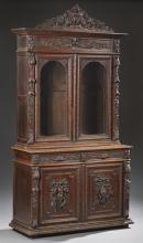 French Henri II Carved Oak Buffet a Deux Corps, 19th c., the architectural stepped crown over two arched glazed doors flanked by fol...