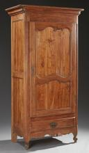 French Louis XV Style Carved Cherry Bonnetiere, 19th c., the stepped rounded corner ogee crown over a large paneled door with iron f...