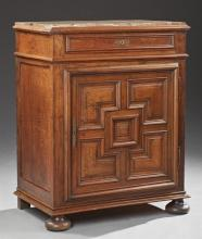 French Carved Oak Marble Top Confiturier, 19th c., the inset highly figured rouge marble over a frieze drawer and a fielded panel cu...