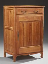 French Provincial Louis Philippe Style Carved Cherry Confiturier, 19th c., the stepped top over a frieze drawer and a cupboard door,...