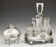 Two Egyptian Motif Silverplated Items, 19th c., consisting of an English cut glass six bottle cruet set by Deykin & Sons; and an Ame...
