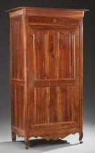 Louis XV Style Carved Cherry Bonnetiere, 19th c., the stepped canted corner crown above a large paneled door, on cabriole legs, join...