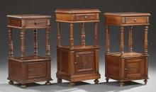 Group of Three French Carved Walnut Marble Top Nightstand, late 19th c., each with an inset figured rouge marble over a frieze drawe...