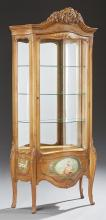 Louis XV Style Carved Cherry Bombe Curved Glass Vitrine, 20th c., the pierced arched crest over an arched curved glass door with a l...