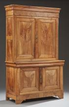Louis Philippe Style Carved Walnut Buffet a Deux Corps, 20th c., the rounded edge ogee crown over two paneled doors, on a base with a..