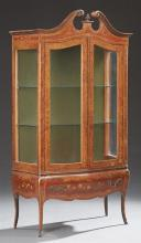 French Louis XV Style Marquetry Inlaid Walnut Bombe Vitrine, early 20th c., the broken arch scrolled crown over double glazed doors,...