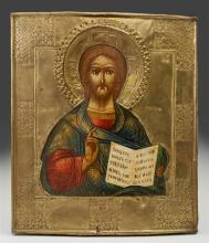 Russian Icon of Christ, 19th c., with a brass oklad, on a curved wooden panel, H.- 12 5/8 in., W.- 10 1/2 in.