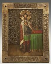 Russian Icon of Saint Alexander Nevsky, 1908-1917, Moscow, with a silver filigree oklad mounted with cabochon semi-precious stones,...