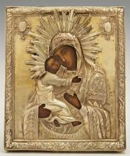 Russian Icon of the Virgin of Vladimir, 1839, Moscow, with a silver oklad, with obscured maker's marks, H.- 5 1/4 in., W.- 4 3/8 in.