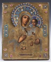 Russian Icon of the Virgin of Tikhvin, Moscow, 1886, with an enameled gilt silver oklad mounted with oval cabochon stones, with a ma...