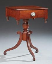 American Classical Style Carved Mahogany Lamp Table, 19th c., the square top over a single drawer with a glass knob above beehive fi...