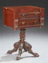 American Federal Carved Mahogany Work Table, 19th c., the rectangular top over two drawers, on a turned carved urn support to four h...