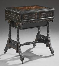 American Aesthetic Ebonized Inlaid Gilt Incised Desk, c. 1880, the lifting lid with an interior mirror over a cantilevered pop-up sl..