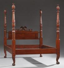 American Federal Revival Carved Mahogany Four Poster Bed, late 19th c., the pineapple and leaf carved posts terminating in cabriole...